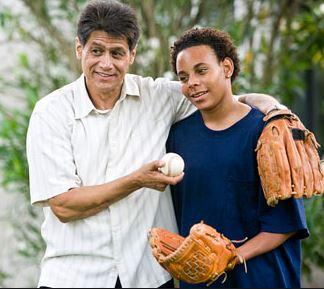 teen boys holding baseball and mitts
