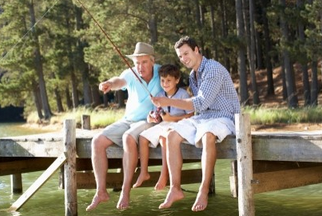 boy fishing with father and grandfather
