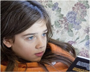 close up of girl's face while reading