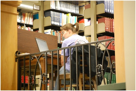 girl studying at computer in library