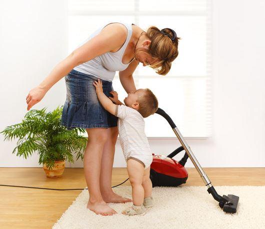 toddler helping mom vacuum
