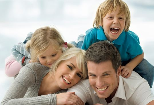 parents and two children laughing together