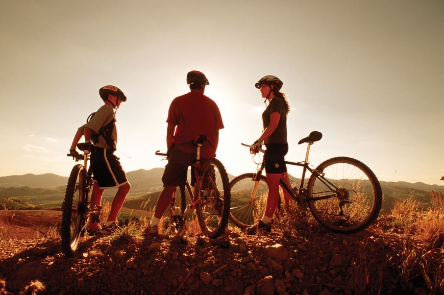 3 people ready to ride their bicycles