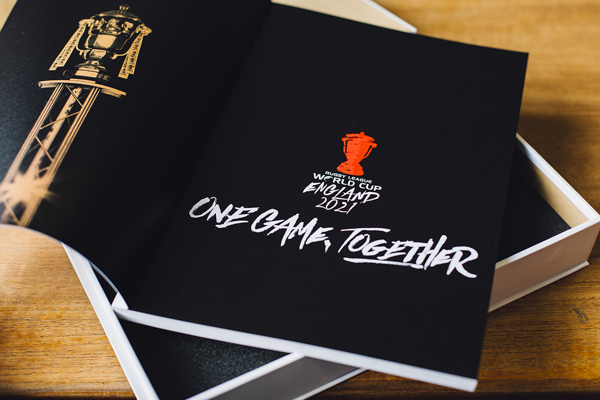 Inside cover of the RLWC 2021 bid book. Earnie creative design