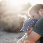 Man Holding Child Grief
