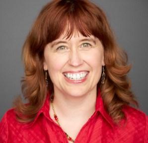 Lauren Torres Smiling Wearing Red