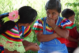 photo of two women conversing