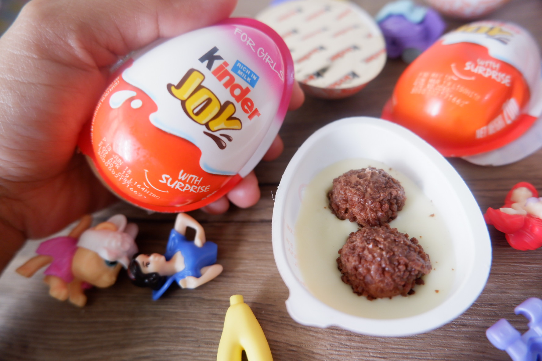 Mom and Child Bonding over Kinder Joy