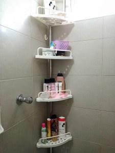 Adjustable bathroom corner rack