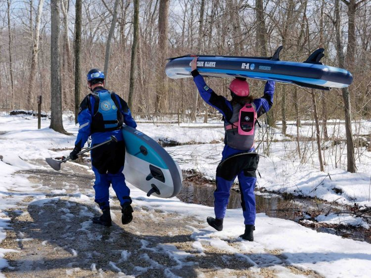 ERS riders with SUP boards in whitewater and the snow