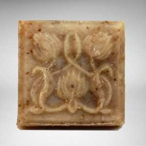 square bar of natural vegan lavender vanilla soap with flower bud design