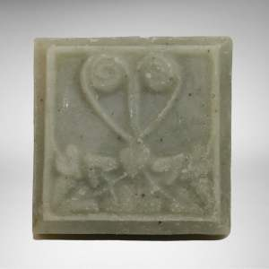 square bar of natural vegan sage rosemary and thyme soap with filigree decoration