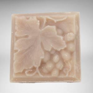 square bar of natural vegan white zinfandel soap with grapes and leaf design