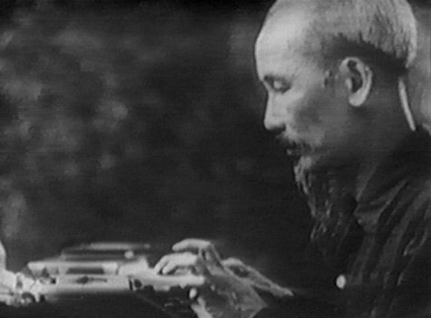 Ho Chi Minh at his typewriter.  Photo from EarthStation 1