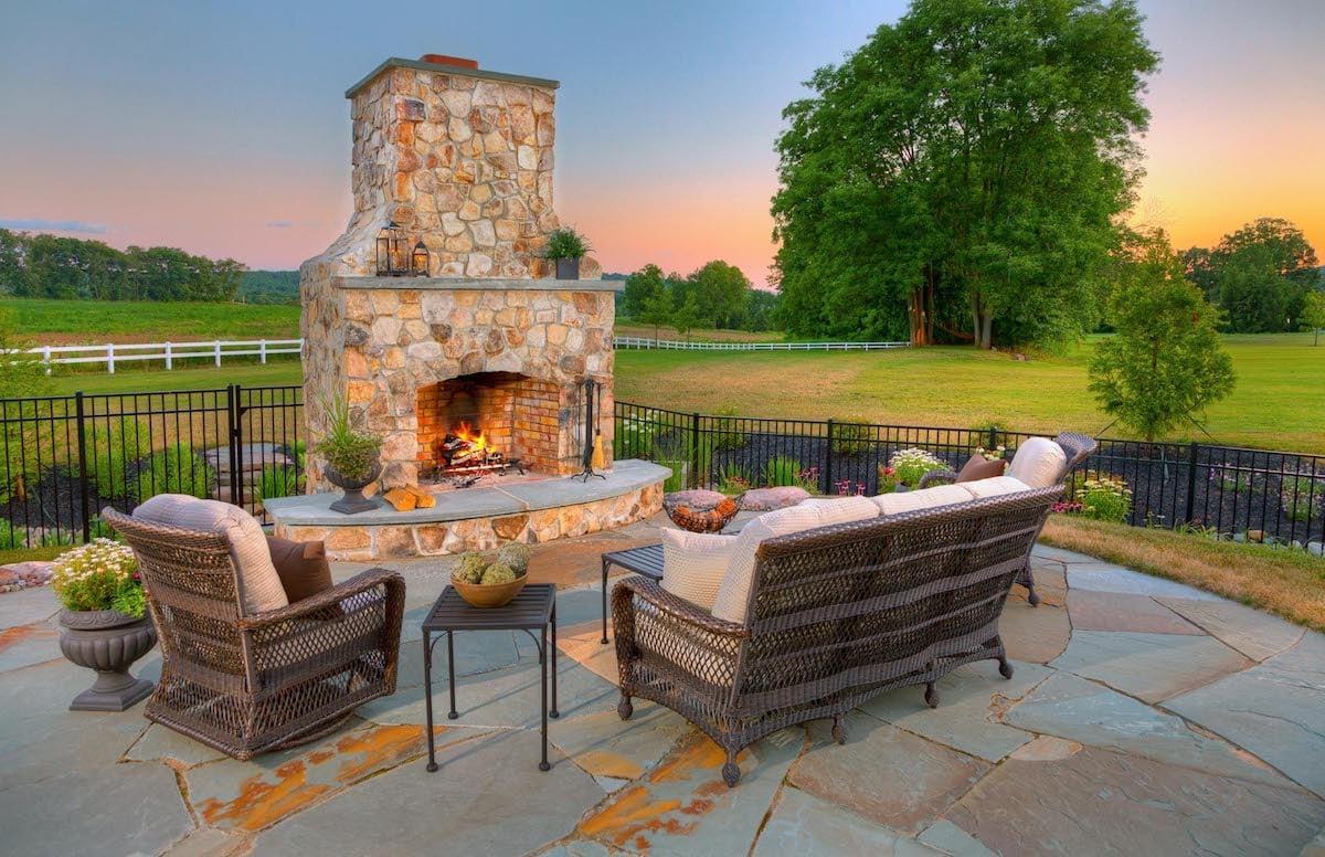 an outdoor fireplace vs a fire pit
