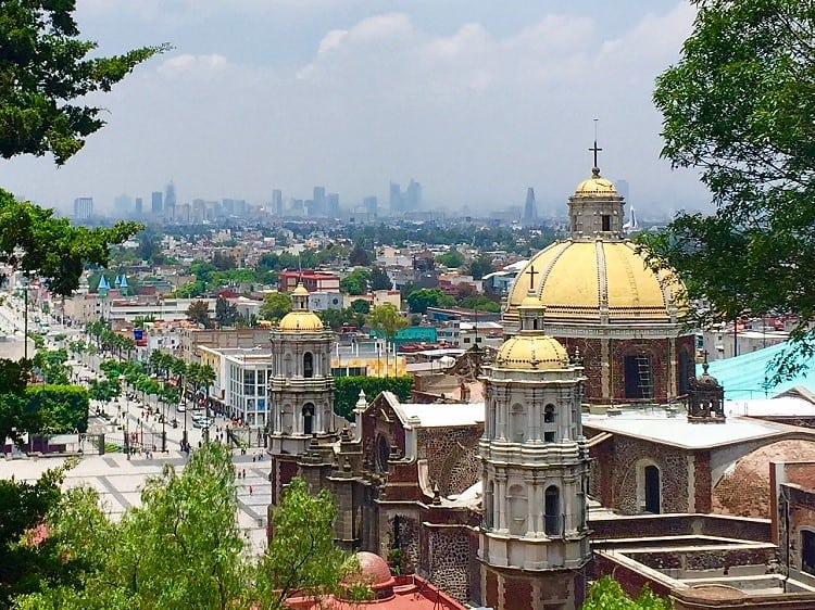 amazing view of mexico city from the hill at our lady of guadalupe church, included in the mexico city travel guide by earth vagabonds