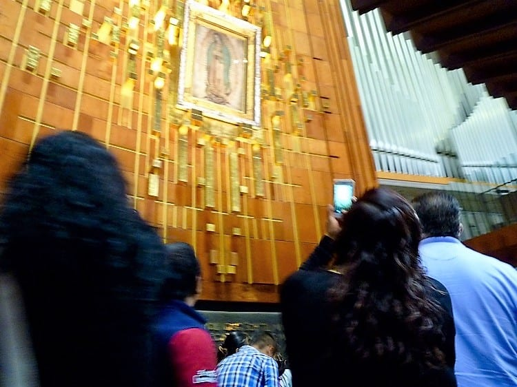 people looking at our lady of guadalupe -- a site to see in the mexico city travel guide