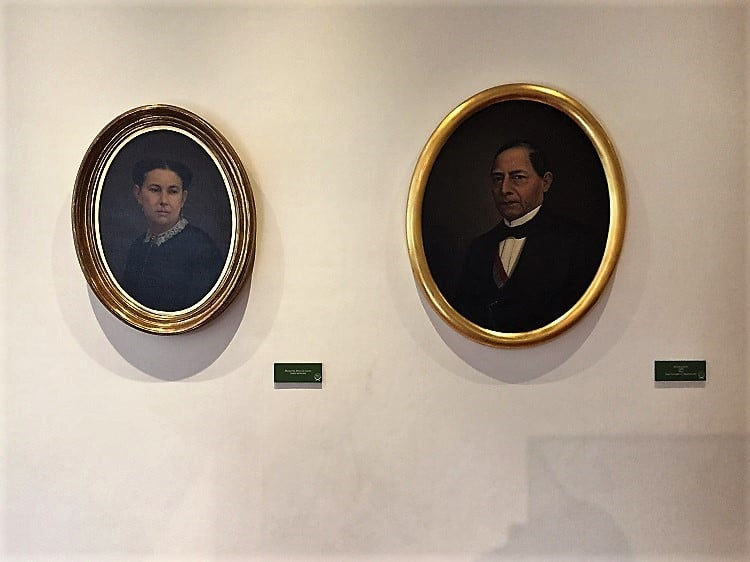 mexico city travel guide: portraits of benito juarez and his wife inside the national palace
