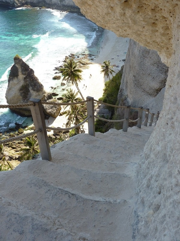stairs carved into rock at atuh beach on nusa penida