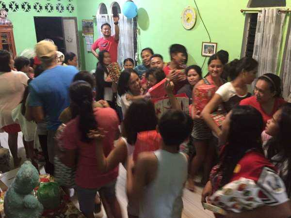 A family gift exchange circle was part of my cultural travel lesson in the Philippines