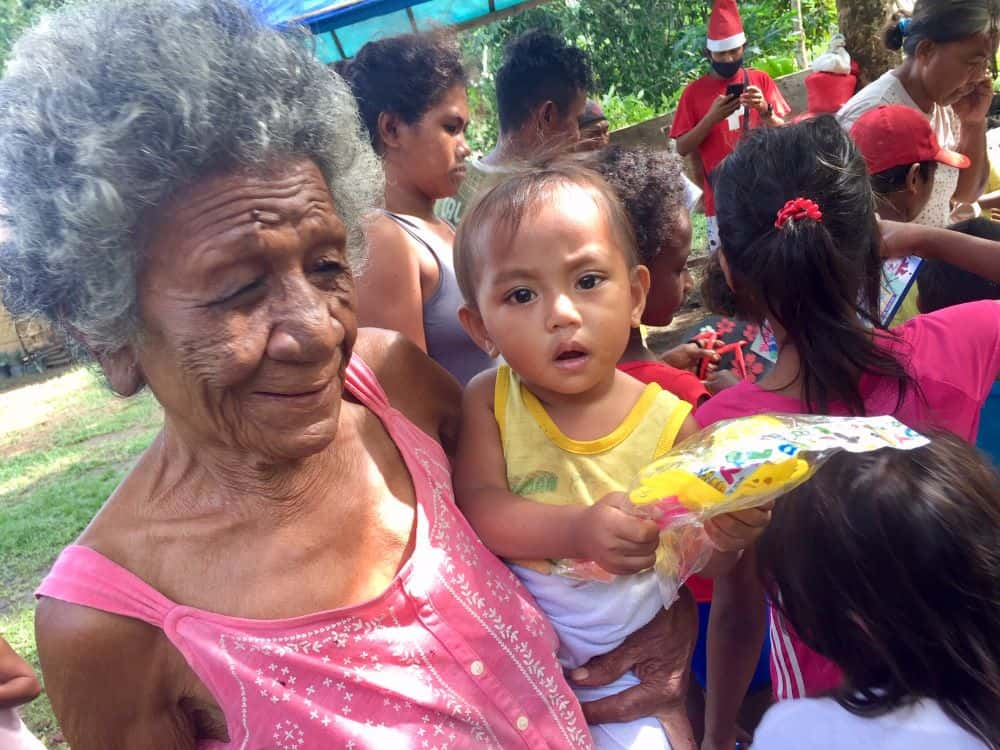 Grandma and child at the early Christmas delivery for the Ati tribe in Malay, Philippines.