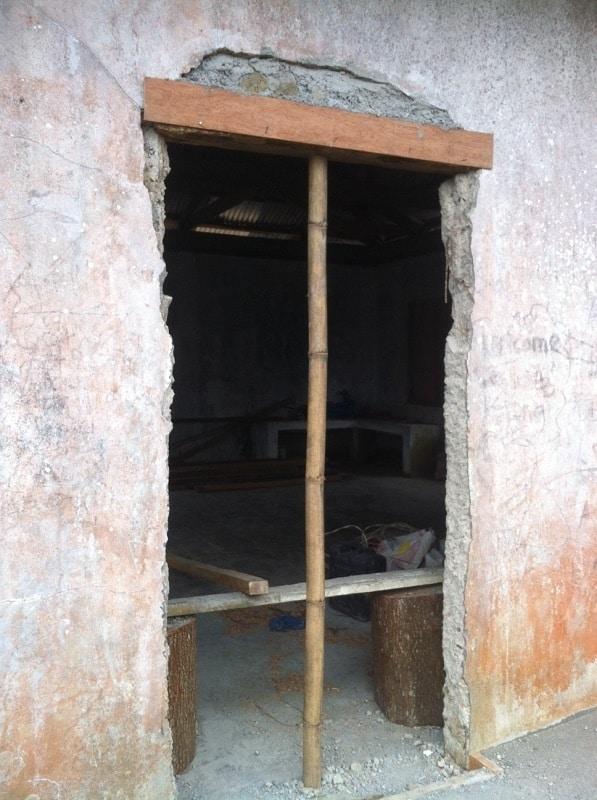 damaged doorway at Kurong community center