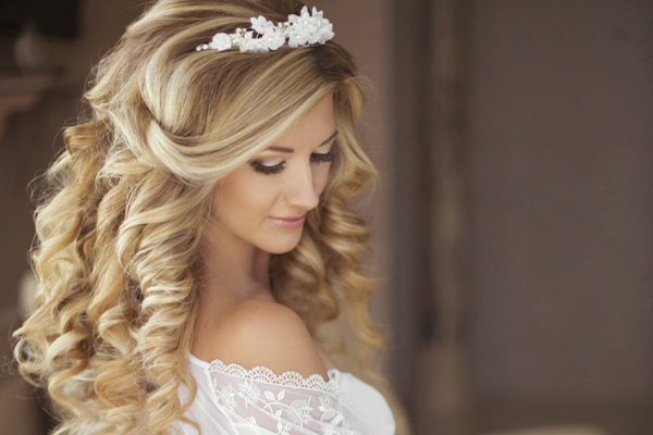 healthy hair beautiful smiling bride with long blonde curly hairstyle and bridal makeup attractive