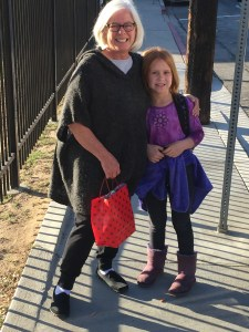 Grandmother and granddaughter walking to school