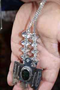 Domed dimes applied to necklace
