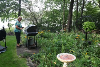 Grilling beside cottage garden