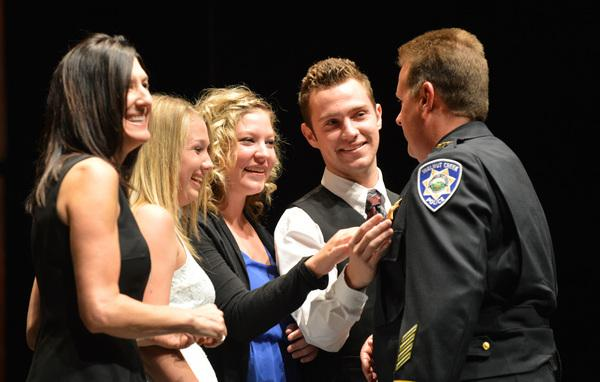 Walnut Creek's new Chief of Police, Tom Chaplin, is surrounded by his family, from left, wife Julie, daughters Taylor and Stephanie, and son Justin after being sworn in at the Lesher Center for the Arts in Walnut Creek, Calif., on Tuesday, July 16, 2013. (Dan Rosenstrauch/Bay Area News Group)