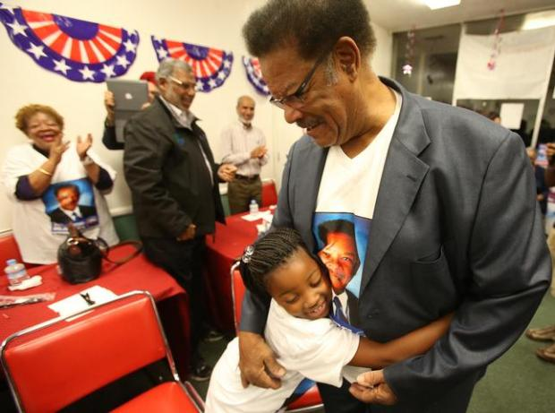 Richmond mayoral candidate Nat Bates, right, hugs supporter Cherish Lincoln, 7, left, during an election night party on Tuesday, Nov. 4, 2014, in Richmond, Calif. (Aric Crabb/Bay Area News Group)