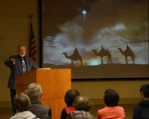 Saint Mary's College's astrophysicist Ron Olowin talks about the nature of the Star of Bethlehem, a popular symbol of the Christmas season, during a Community Hall event held at the Lafayette Library in Lafayette, Calif., Wednesday, Dec. 10, 2014. (Susan Tripp Pollard/Bay Area News Group)