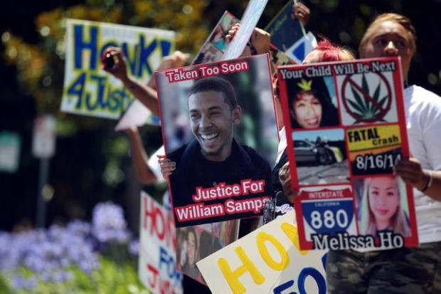 Family, friends and supporters of William Sampson hold a protest outside the Fremont Hall of Justice in Fremont, Calif., Wednesday, June 24, 2015. Sampson, 22, of Sacramento, was fatally struck by a car on Interstate 880 in Fremont in August 2014. The driver of the car Melissa Ho, of San Jose, has been charged with vehicular manslaughter and is due to appear in court for a preliminary hearing. (Anda Chu/Bay Area News Group)