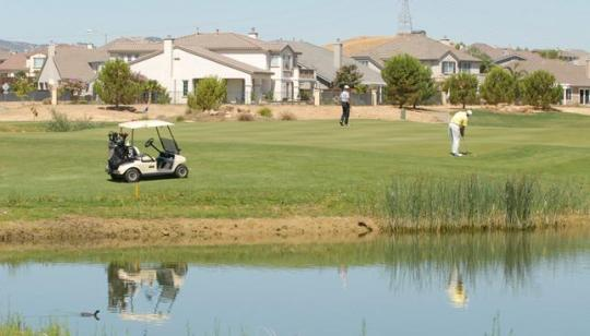 Shadow Lakes golf course eliminates daily play on a temporary basis     A pair of golfers play a hole in the Shadow Lakes subdivision  The area  could change considerably as the developer wants to consolidate the course  with Deer
