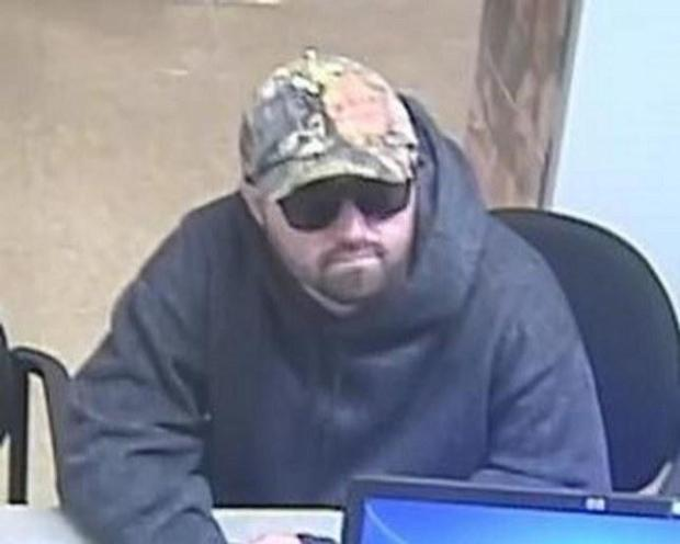 "A surveillance photo shows a man dubbed the ""Bearded Bandit"" wanted for a series of bank robberies including this one in Gilroy, Calif., on March 4, 2016. (FBI)"