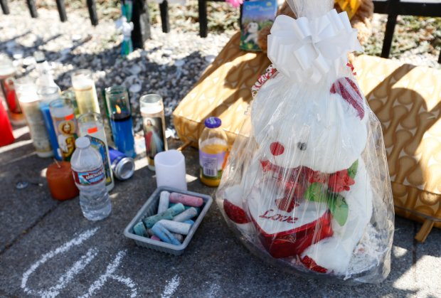 A teddy bear is seen at a memorial for accident victim Jeremiah Esera, 2, at 35th and Penniman Avenues in Oakland, Calif., on Wednesday, Sept. 21, 2016. The boy was hit and killed by an AC Transit bus on Tuesday when he ran into the street, police said. (Jane Tyska/Bay Area News Group)