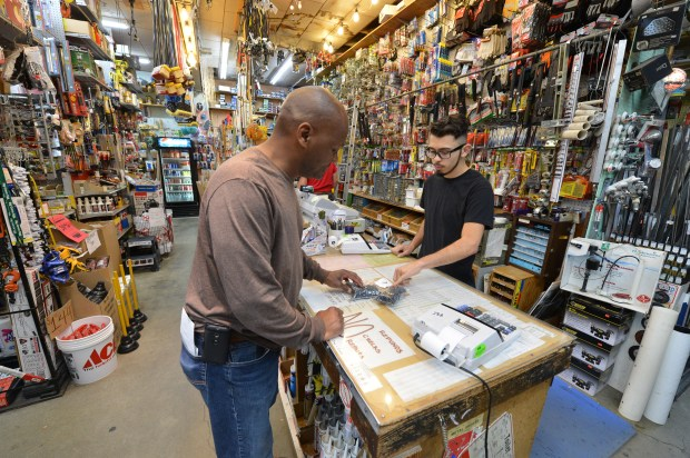 Andres Sandoval, right, helps customer Terrence Marshall at the Eames brother's Ace hardware store in Richmond, Calif. on Thursday, Sept. 1, 2016. After 42 years, Bob and Patrick Eames have decided to retire and are closing the store. (Kristopher Skinner/Bay Area News Group)