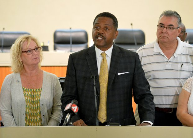 Antioch Mayor Pro Tem Lori Ogorchock, left, and Council Member Tony Tiscareno, right, stand next to Mayor Wade Harper as he talks during a press conference held at Antioch City Hall in Antioch, Calif., on Thursday, Sept. 8, 2016. Harper held the press conference to discuss a hate crime at occurred at approximately 3:15 a.m. on Wednesday, Sept. 7, when a Antioch home was targeted with Molotov cocktails and hateful graffiti. (Doug Duran/Bay Area News Group)