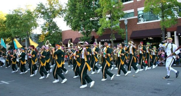 The Concord High Minutemen Marching Band, with drum major Jeremy Sullivan, in the Walnut Festival Twilight Parade, win first place in the three top categories: marching band, drum major, and auxiliary.