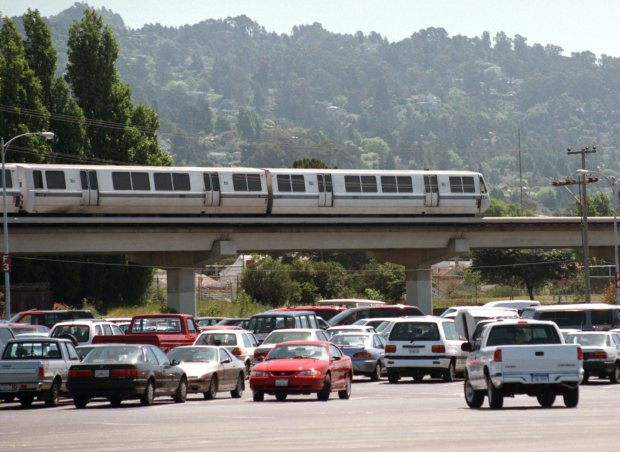 A BART train cruises past the El Cerrito Plaza parking lot on Wednesday, April 30, 1997. El Cerrito Plaza is the subject of a redevelopment debate. (WEST COUNTY TIMES/MARK DuFRENE) WCERRIT1