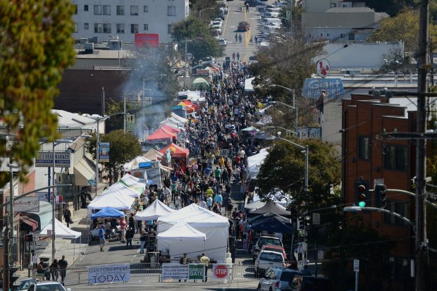 A crowd fills the streets of the Dimond District at the ninth annual Oaktoberfest on Oct. 1, 2016. (Dan Honda/Staff archives)