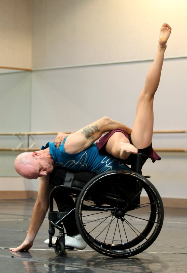 Dwayne Scheuneman, left, and Lani Dickinson dance during a performance by the Axis Dance Company an ensemble of performers with and without disabilities in Oakland, Calif., on Saturday, Oct. 29, 2016. (Anda Chu/Bay Area News Group)