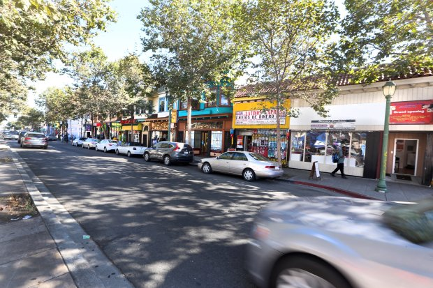 Vehicles are parked on International Boulevard in the Fruitvale business district in Oakland, Calif., on Tuesday, Aug. 30, 2016. The parking spots will be removed once the Bay Rapid Transit corridor is built along International Boulevard from San Leandro BART station to downtown Oakland. The lack of parking is a concerned for many merchants. (Ray Chavez/Bay Area News Group)