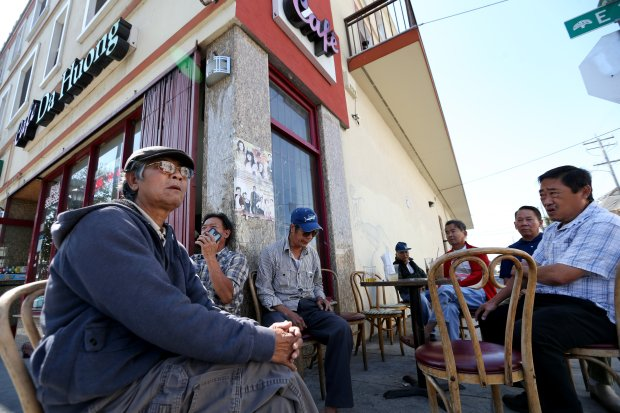 Patrons hang out outside a Vietnamese cafe on East 12th Street and 6th Avenue in Oakland, Calif., on Tuesday, Aug. 30, 2016. Part of the Bay Rapid Transit corridor will be built on East 12th Street between Lake Merritt and 14th Avenue to continue its route along International Boulevard to the San Leandro BART station.. (Ray Chavez/Bay Area News Group)