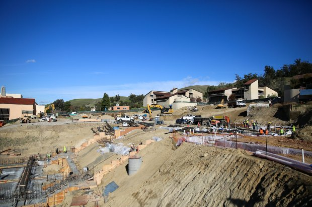 Construction continues on the academic core project at the center of Ohlone College's Fremont campus. The planned three buildings of the core will each house facilities for various disciplines. The $180 million project is expected to be completed in Summer 2019.
