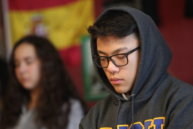 Sophomore Jonathan Pallen, 15, right, and freshman Hannah Nance, 14, left, and attend a 30-minute mindfulness session at Monte Vista high school in Danville, Calif., on Tuesday, Dec. 20, 2016. Allan Isbell a former substitute teacher at the school is helping students with the stress of finals week by teaching meditation and other relaxation techniques. (Anda Chu/Bay Area News Group)
