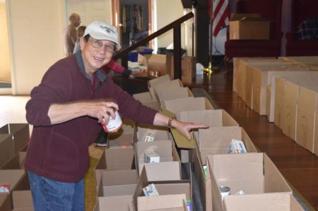 Benjamin Yiph, volunteer and pastor of Chinese Christian Church, sorts boxes of donated food earlier this week. The Food for Thought project distributed food to 150 families with children in the West Contra Costa Unified School District.
