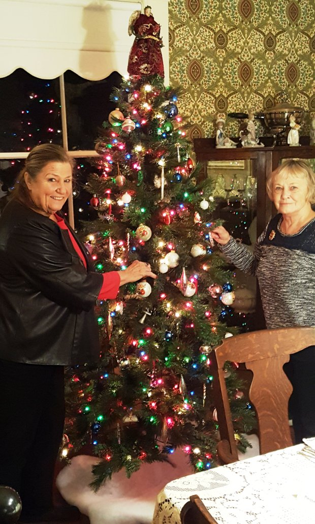 Concord Historical Society President Carol Longshore and Galindo Home docent Jan Tolan put the finishing touches on the Christmas tree to welcome visitors touring the beautifully decorated historic home during the holidays.