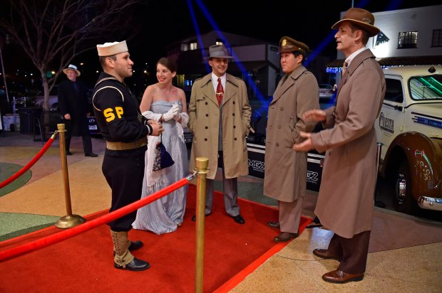 Ray Raygoza, of Suisun, from left, Inna Eydelnant, of Vallejo, Evan Cray, of Napa, Daniel Inouye, of Vallejo, and Thomas Gallegullos, of Alameda, dress in 1940's attire while attending the Orinda Theatre 75th anniversary gala celebration in Orinda, Calif., on Thursday, Dec. 29, 2016. The 800-seat art deco theater was built between 1937-1941 by local developer Donald Rheem. (Jose Carlos Fajardo/Bay Area News Group)